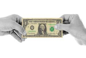 person holding one dollar bill