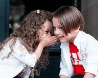 kids sharing a secret