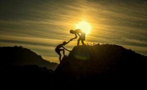helping hand up the cliff