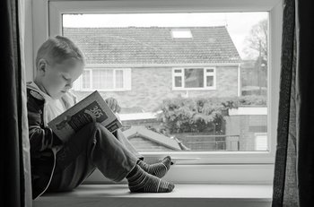 student reading in the window